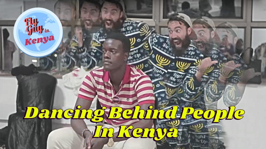 Dancing behind people in Kenya